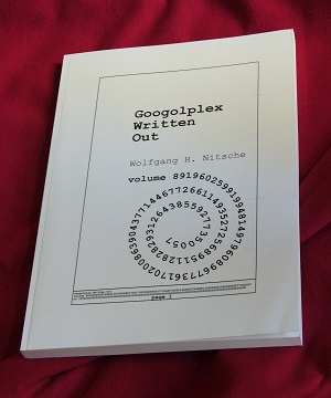 Googolplex Written Out (photo of one soft-cover book)
